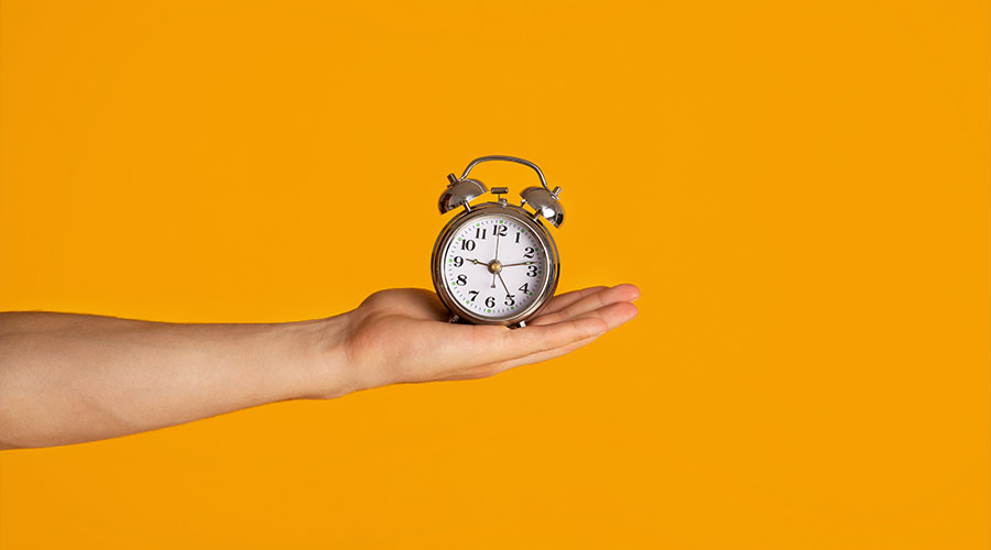 hand-holding-clock